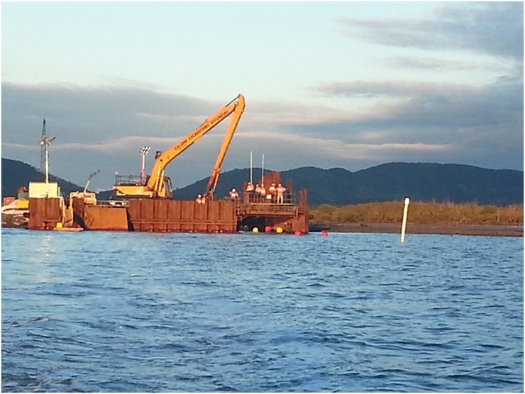 Pipestring exiting mainland cofferdam <br>